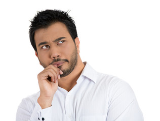 Clueless, worried man sucking up his thumb, daydreaming