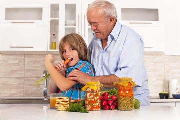 grandson and grandfather eat healthy foods