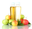 two bottles of juice with sweet apples, isolated on white