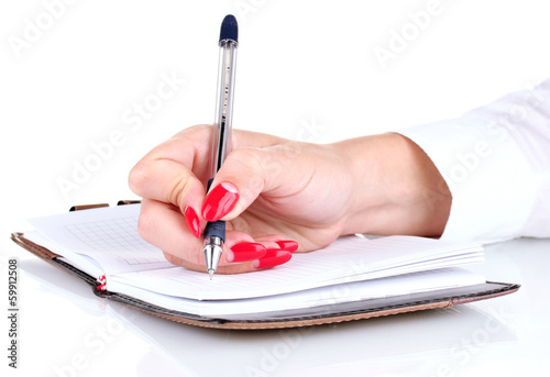Hand signing in notebook isolated on white