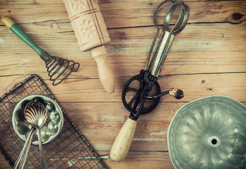 Assorted cooking utensils on a wooden table
