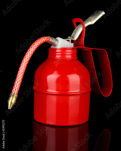 Red oil can, isolated on black