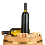 Wine and corks on barrel isolated on white