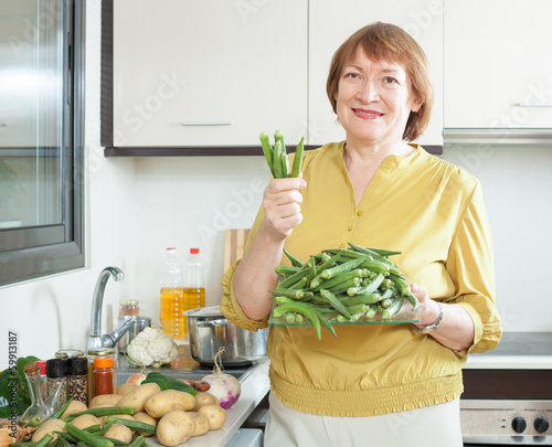 mature housewife cooking  okra