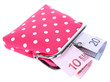 Pink purse with money isolated on white