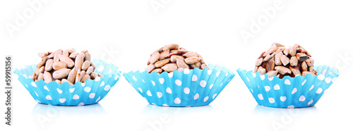 Chocolate candies with sunflower seeds, isolated on white