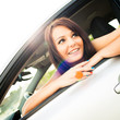 Cute, happy young female driver