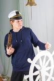 disgruntled sailor at the helm with a gun