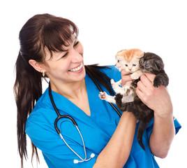 vet holds three kittens. isolated on white background