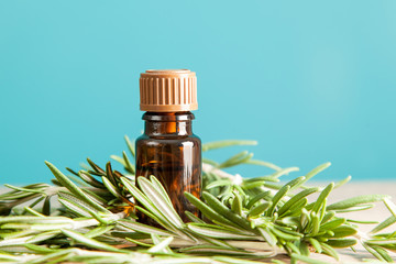 Bottle with aromatic oil and rosemary
