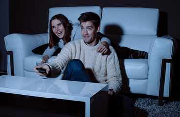Couple in love watching a comedy on TV