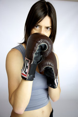 Strong beautiful female boxer defense