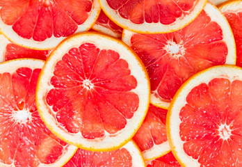 Texture of a ripe grapefruit slice