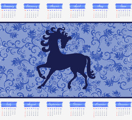 Calendar for 2014 with a horse on a blue background
