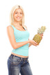 Smiling female holding pineapple