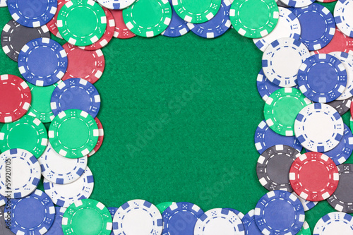 frame with colorful poker chips on the green table