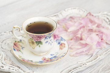 Tea cup with peony petals