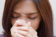 woman praying with holy cross, closed eye