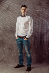 full length portrait of a casual young man standing with both