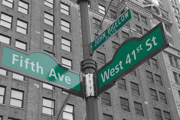 Street signs for John Bigelow Plaza in NYC