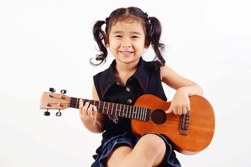 kid playing ukulele