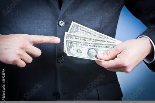 businessman with dollars in his hand, concept earn money