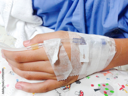 close up of hand with  IV solution in a patients in hospital wit