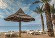 Sunshade on the golden beach of the Red Sea, Eilat