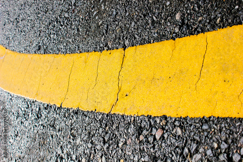 asphalt road yellow line close up background