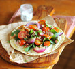 Homemade wheat flat bread with vegetable salad