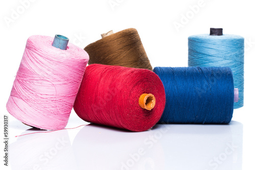 Tailoring. Many colorful threads on white background