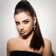 Vogue. Beautiful woman posing in black dress