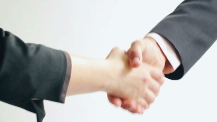 Handshake of two young people in suits