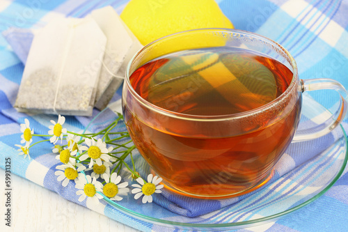 Chamomile tea with fresh chamomile flowers and lemon