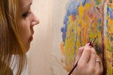 Young female artist painting landscape