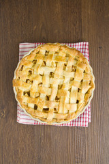 Apple pie on gingham towel, cooked