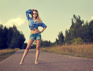 Sexy Blonde Woman Standing on the Road