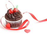 festive  cupcake decorated with chocolate and berries