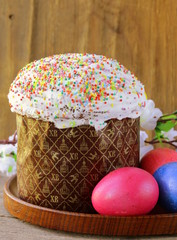 traditional Easter cake with glace icing and colorful eggs