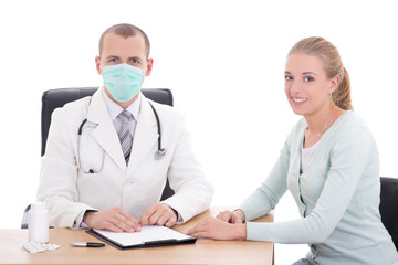 young doctor in mask and female patient sitting isolated on whit