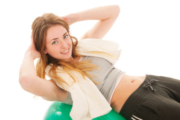 sport woman with ball training the abs