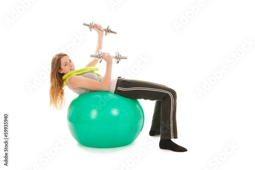 sport woman with ball lifting dumbells