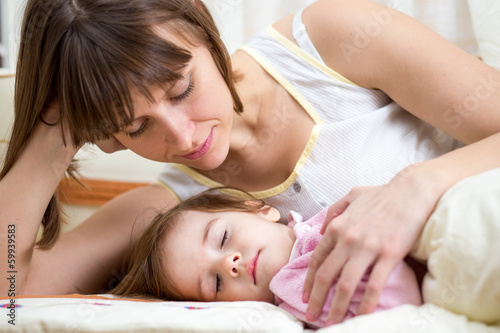 mother looking at sleeping kid
