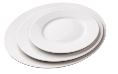 Three empty plates of different sizes over white background