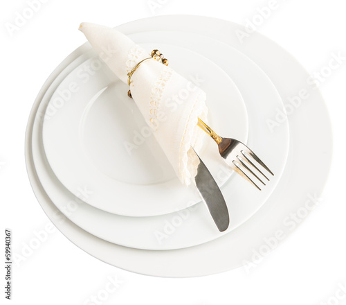 Leinwandbild Motiv Empty plate with fork, knife and napkin on white background