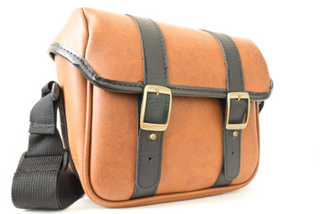 The brown leather messenger bag