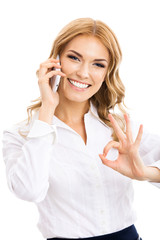 Businesswoman with phone, showing okay gesture