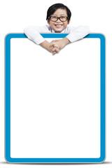 Boy holding a blank board
