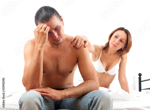 Sad middle-aged man has problem, a wife comforting him