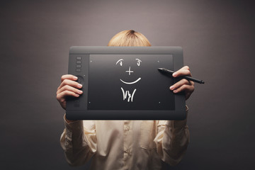 Young man holding a graphics tablet (concept)